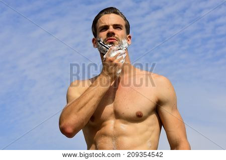 Macho With Unshaved And Dreamy Face On Clear Sky Background