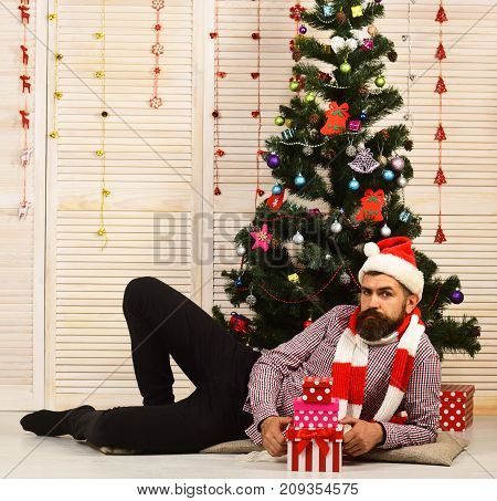 Santa Claus With Serious Face With Christmas Tree On Background