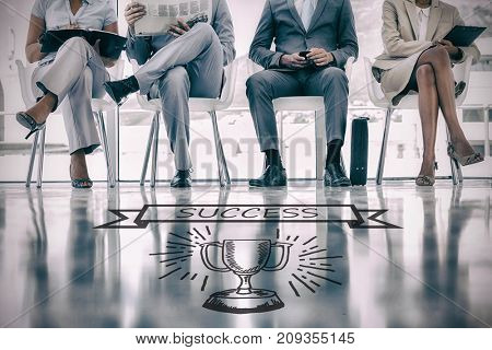 Graphic image of success text on banner over trophy against group of well dressed business people waiting