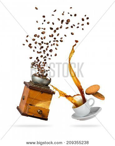 Splashing coffee drink from the cup with flying beans and grinder, isolated on white background