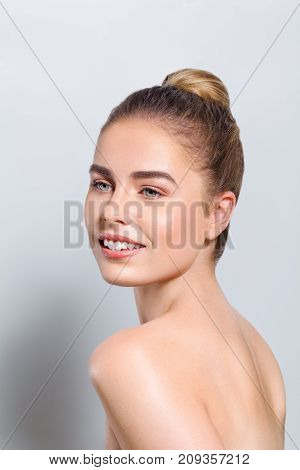 Beautiful young woman head beauty portrait with perfect skin isolated on white background