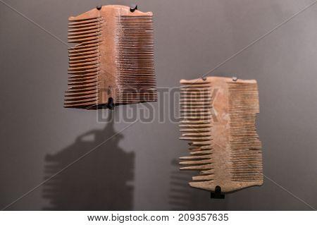 JERUSALEM, ISRAEL - OCTOBER 13 2017: Small combs found at Qumran site. Israel Museum Jerusalem. Israel.