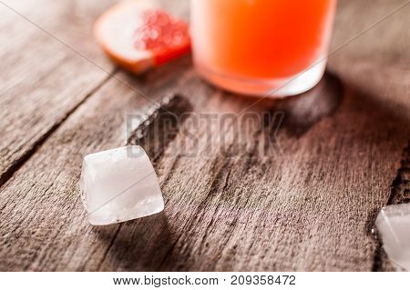 Grapefruit Cocktail With Ice And Salt On A Wooden Background. Party Time