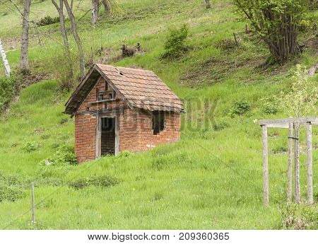 small rural tool shed at a hillslope