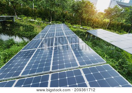 Ecological energy renewable solar panel plant in modern city