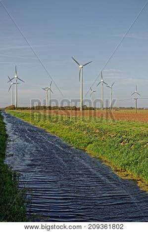 Wind turbines and drainage dyke in LincolnshireUK. HDR Image