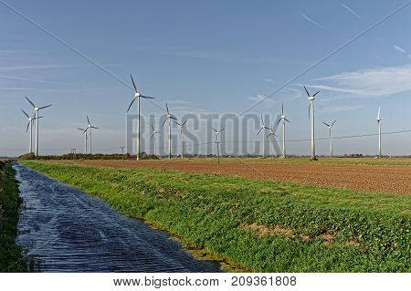 Wind turbines and drainage dyke in LincolnshireUK