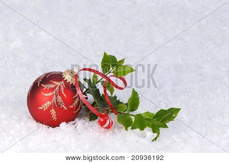 christmas ornament with holly and ribbon