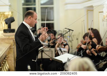MOSCOW - SEP 16, 2017: Conductor and musicians at Great Catherine Ball (dance party) in Tsaritsyno
