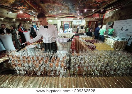 MOSCOW - JUN 8, 2017: Waiter pours wine at Award Records of real estate market 2017 in Golden Palace