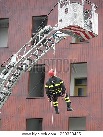 Firefighter During A Training Exercise With The Rope To Descend