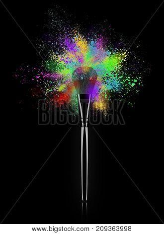 Make up brush with burst of colorful powder close-up on black background