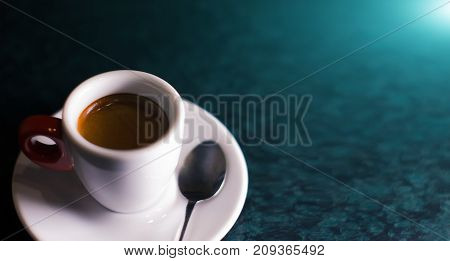 A cup of coffee is americano on a dark background