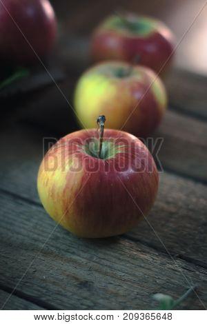 Fresh ripe apples on a wooden background. Autumn still life