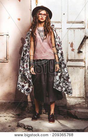 Beautiful sexy fashion woman posing outdoor. Fashionable clothes.