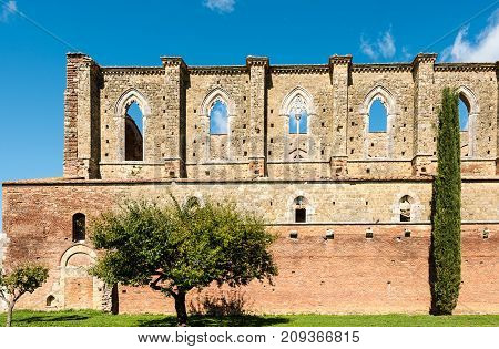 Abbey of Saint Galgano, a former Cistercian monastery without roof today in the valley of the Merse River - San Galgano, Tuscany, Italy.