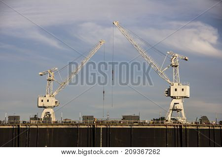 The dry dock for reconstruction of the ships and cranes above ready to work
