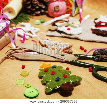 lot of stuff for handmade gifts, scissors, ribbon, paper with countryside pattern, ready for holiday concept, nobody home close up