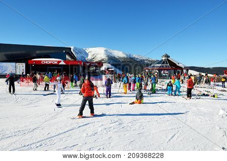 JASNA SLOVAKIA - JANUARY 22: The skiers and Chopok cableway station in Jasna Low Tatras. It is the largest ski resort in Slovakia with 49 km of pistes on January 22 2017 in Jasna Slovakia