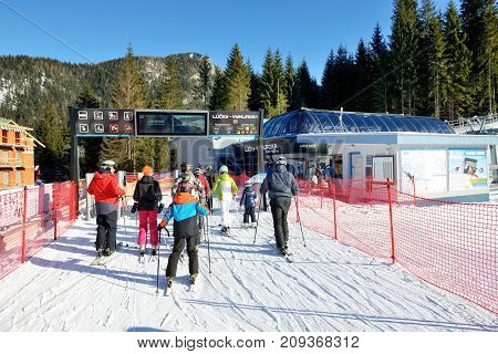 JASNA SLOVAKIA - JANUARY 22: The skiers and Lucky-Vyhliadka cableway station in Jasna Low Tatras. It is the largest ski resort in Slovakia with 49 km of pistes on January 22 2017 in Jasna Slovakia