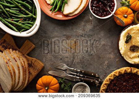 Thanksgiving table with turkey, green beans and mashed potatoes overhead shot
