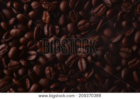 Traditional Brown Hot Coffee Beans With Steam Smoke.