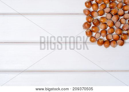 Nuts hazel on a white wooden background