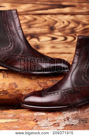Brown Leather Chelsea Boots Polished On Pine Board. Waxing Boots.copy Space.