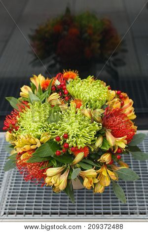 Autumn bouquet of chrysanthemum, carthamus, nutans, hypericum and alstroemeria flowers