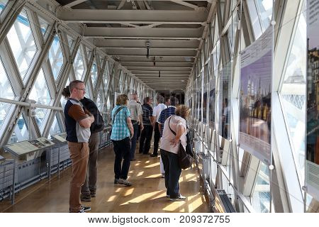 LONDON, GREAT BRITAIN - MAY 16, 2014: Visitors examine the exhibition at the observation deck of the Tower Bridge.
