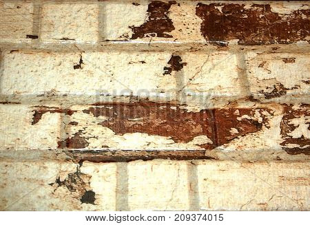 Brick wall of white brick with brown spots. background