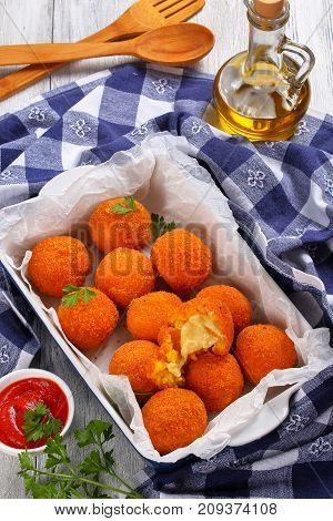 Arancini - Saffron Rice Balls Stuffed With Cheese