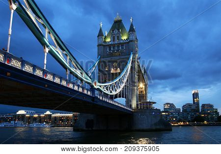 Tower Bridge over the thames river at night in London, United Kingdom, England