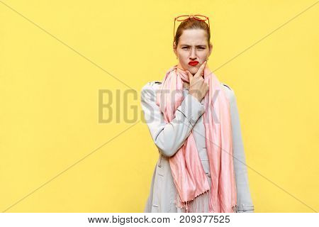 Pretty Ginger Girl At Autumn. Wearing In Coat And Pink Scarf, And Thinking. Isolated Studio Shot On
