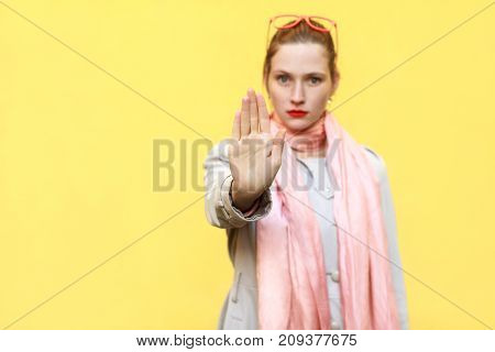 Negative Human Emotions, Body Language. Young Adult Woman With Bad Attitude Making Stop Gesture With