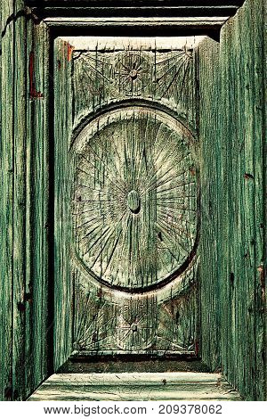 carving on the front green door strikes.