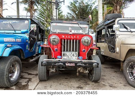 SALENTO COLOMBIA - JUNE 6: Red Willys Jeep in the plaza in Salento Colombia on June 6 2016