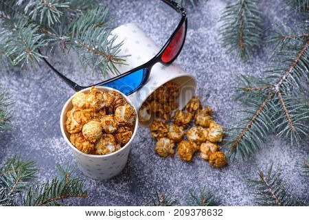 Caramelized popcorn and 3d glasses. Christmas theme