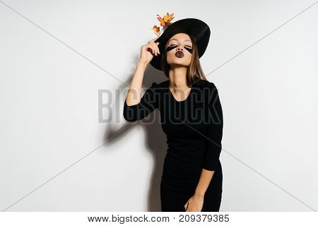 A young gothic girl dressed in a witch for Halloween,