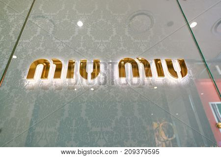 BUSAN, SOUTH KOREA - MAY 28, 2017: close up shot of Miu Miu sign. Miu Miu is an Italian high fashion women's clothing and accessory brand and a fully owned subsidiary of Prada.