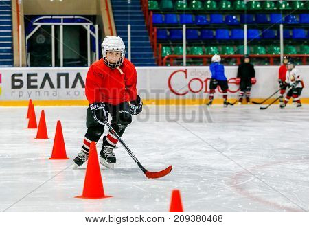 Grodno Belarus - October 17 2017: Ice hockey practice with player and coach during a drill