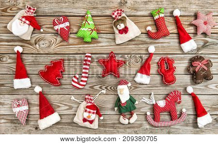 Christmas decoration on rustic wooden background. Vintage style toned picture