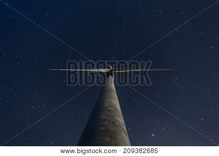 Windmill Under The Starry Sky At Night