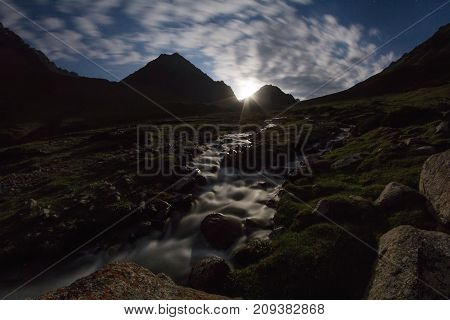 Moonrise Over A Mountain Stream At Night