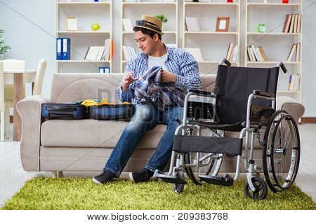 Young disabled man preparing for summer vacation