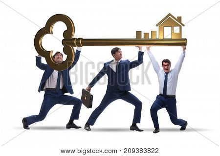 Businessmen holding giant key in real estate concept