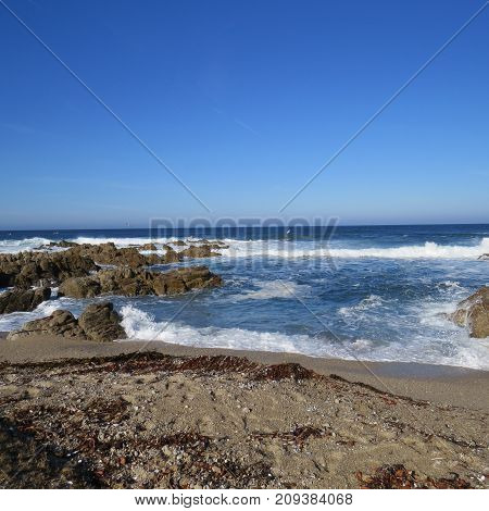 an image of the incoming tide taken at Asilomar State Preserve in Pacific Grove, California.