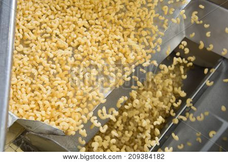 industrial production of pasta on automated food factory.