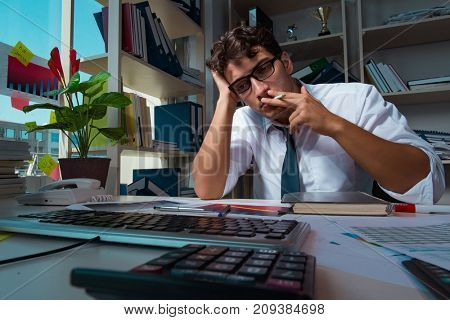 Man businessman working late hours in the office