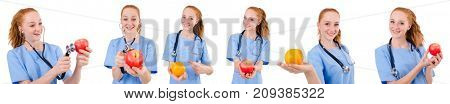 Pretty doctor  in blue uniform with stethoscope and apple  isola